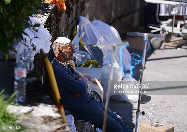 TOPSHOT An injured man looks on after a strong earthquake hit his village in Amatrice on August 24 2016 A powerful 62magnitude earthquake devastated...