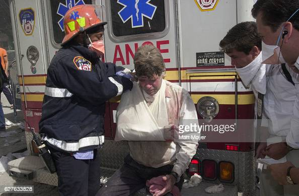 An injured man receives care from emergency workers after the terrorist attack on the World Trade Center on Sept 11 2001