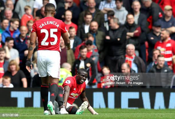 An injured Manchester United's Eric Bailly sits on the pitch during the Premier League match at Old Trafford Manchester