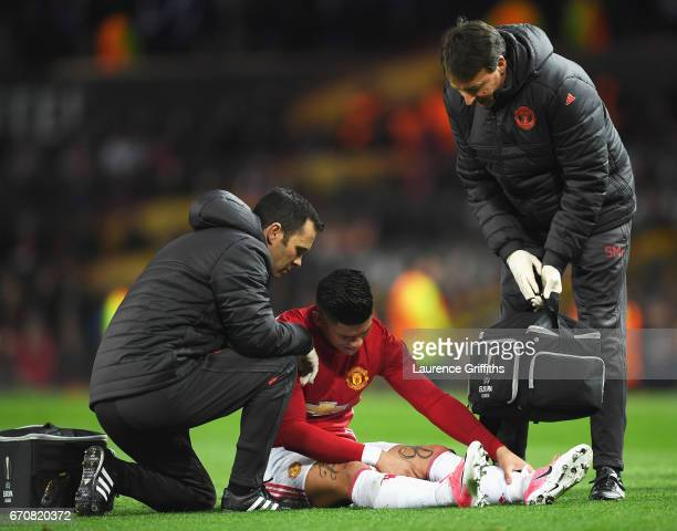 An injured Marcos Rojo of Manchester United is given treatment during the UEFA Europa League quarter final second leg match between Manchester United...