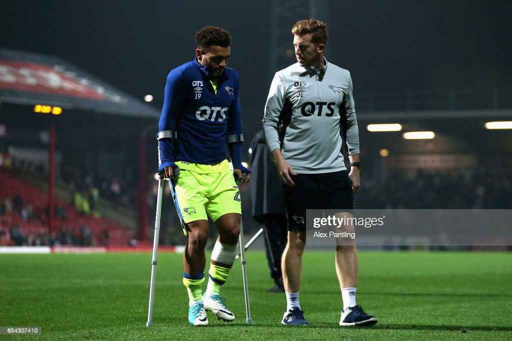 An injured Mason Bennett of Derby County leaves the pitch on crutches during half time of the Sky Bet Championship match between Brentford and Derby County at Griffin Park on September 26, 2017 in Brentford, England.