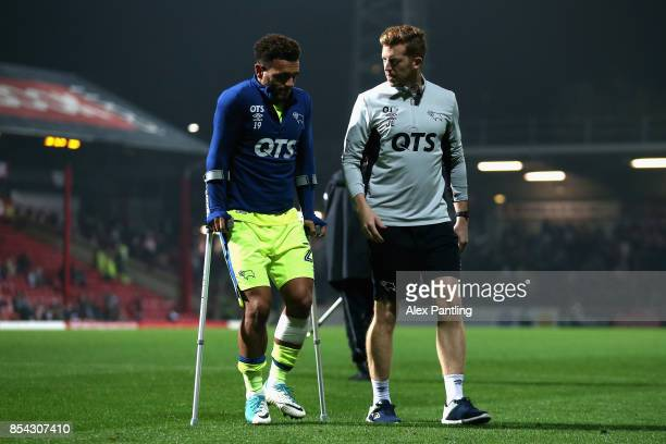 An injured Mason Bennett of Derby County leaves the pitch on crutches during half time of the Sky Bet Championship match between Brentford and Derby...