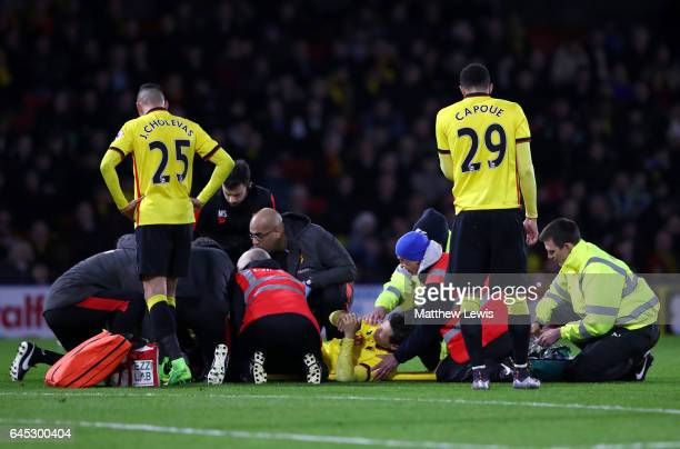 An injured Mauro Zarate of Watford is given treatment during the Premier League match between Watford and West Ham United at Vicarage Road on...