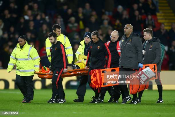 An injured Mauro Zarate of Watford is stretchered off during the Premier League match between Watford and West Ham United at Vicarage Road on...