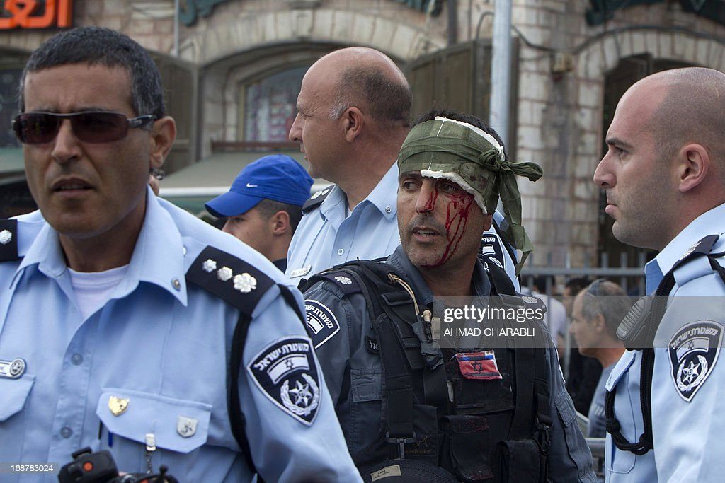 An injured member of the Israeli security forces is seen after clashes broke out near Damascus gate in Jerusalem on May 15, 2013 as Palestinian demonstrators held a rally to mark the 65th Nakba or 'catastrophe' of the Jewish state's creation in 1948, during which 760,000 Palestinians fled their homes. Thousands of Palestinians took to the streets in the West Bank and the Gaza Strip to demonstrate on Nakba Day and assert their 'right to return' to where their ancestors fled after the Israeli victory over Arab armies.
