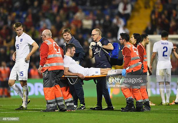 An injured Michael Carrick of England is stretchered off during the international friendly match between Spain and England at Jose Rico Perez Stadium...