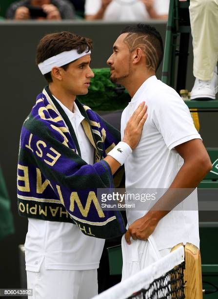 An injured Nick Kyrgios of Australia is consoled by PierreHugues Herbert of France as he retires during the Gentlemen's Singles first round match on...