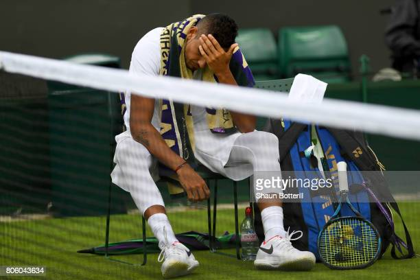 An injured Nick Kyrgios of Australia reacts as he retires during the Gentlemen's Singles first round match against PierreHugues Herbert of France on...