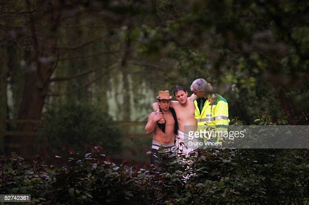 An injured Oxford University student is is helped by a friend and a paramedic after jumping into the river from Magdalen Bridge to celebrate May Day...