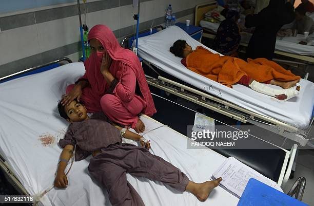An injured Pakistani child victim of a suicide blast rests in a hospital in Lahore on March 28 2016 A suicide bomber who attacked a park thronging...
