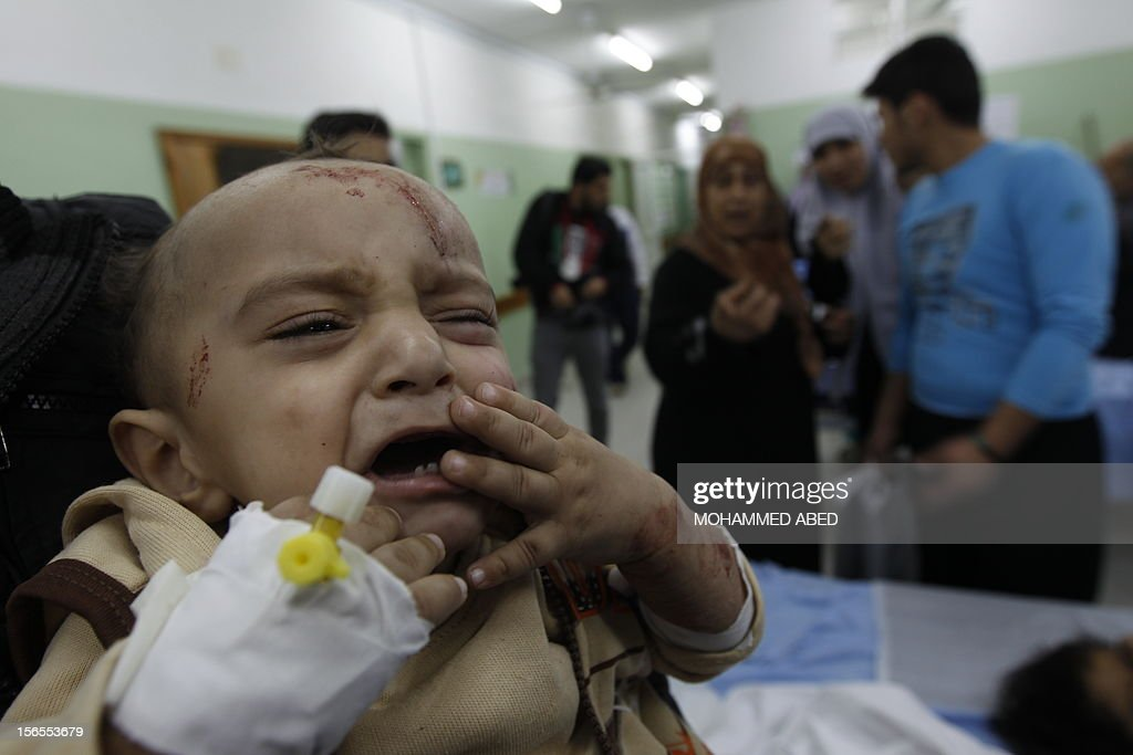 An injured Palestinian child cries at a hospital following an Israeli air raid in Beit Lahia, the northern Gaza Strip on November 17, 2012. Israeli air strikes hit the cabinet headquarters of Gaza's Hamas government, the group said early on November 17, with eyewitnesses reporting extensive damage to the building.