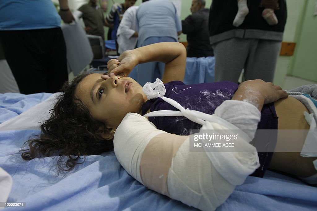 An injured Palestinian child lies on a hospital bed following an Israeli air raid in Beit Lahia, the northern Gaza Strip on November 17, 2012. Israeli air strikes hit the cabinet headquarters of Gaza's Hamas government, the group said early on November 17, with eyewitnesses reporting extensive damage to the building. AFP PHOTO / MOHAMMED ABED