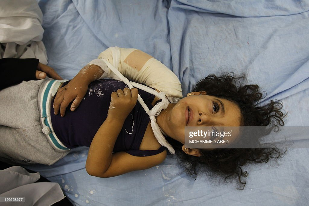 An injured Palestinian child lies on a hospital bed following an Israeli air raid in Beit Lahia, the northern Gaza Strip on November 17, 2012. Israeli air strikes hit the cabinet headquarters of Gaza's Hamas government, the group said early on November 17, with eyewitnesses reporting extensive damage to the building.