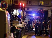 An injured person is evacuate following an attack in the 10th arrondissement of the French capital Paris on November 13 2015 At least 18 people were...