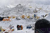 An injured person is helped to a landing area to be loaded onto a rescue helicopter at Everest Base Camp on April 26 a day after an avalanche...