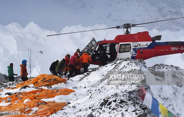 An injured person is loaded onto a rescue helicopter at Everest Base Camp on April 26 a day after an avalanche triggered by an earthquake devastated...
