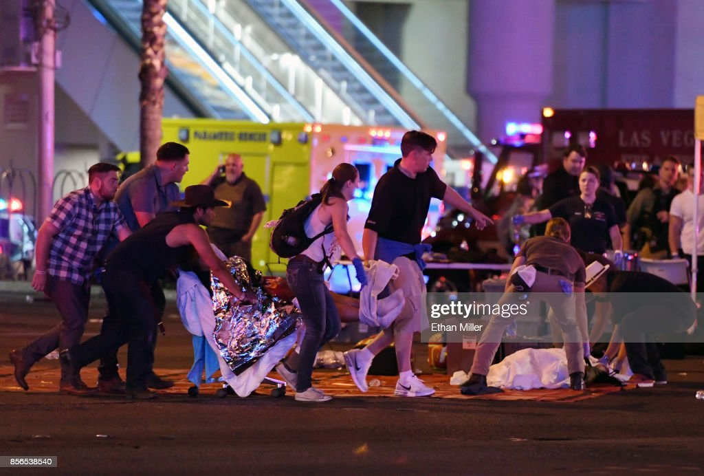 An injured person is tended to in the intersection of Tropicana Ave. and Las Vegas Boulevard after a mass shooting at a country music festival nearby on October 2, 2017 in Las Vegas, Nevada. A gunman has opened fire on a music festival in Las Vegas, killing over 20 people. Police have confirmed that one suspect has been shot dead. The investigation is ongoing.