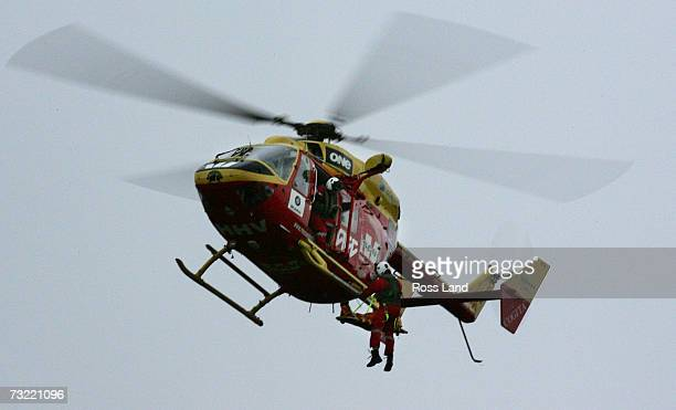 An injured person is winched aboard the Westpac rescue helicopter Sunday August21 after a vehicle left the summit road and crashed down the slopes of...