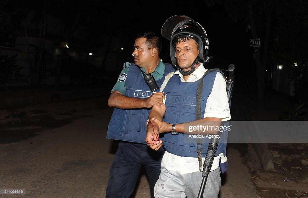 An injured police officer is seen after armed attackers attack to a restaurant in Dhaka, Bangladesh on July 1, 2016.