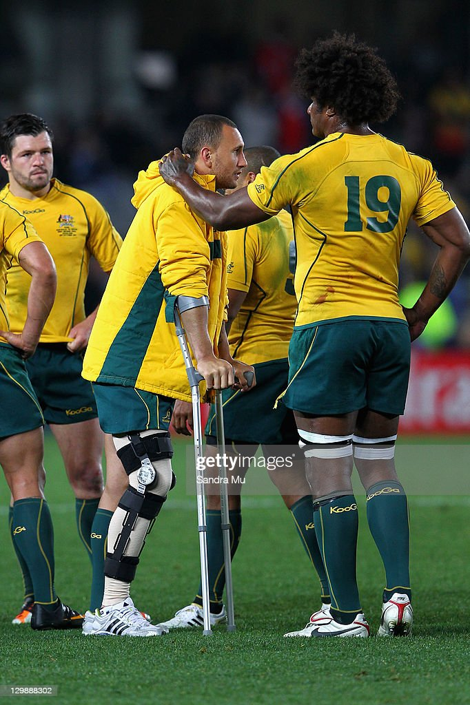 An injured <a gi-track='captionPersonalityLinkClicked' href=/galleries/search?phrase=Quade+Cooper&family=editorial&specificpeople=4176008 ng-click='$event.stopPropagation()'>Quade Cooper</a> of the Wallabies talks with team mate <a gi-track='captionPersonalityLinkClicked' href=/galleries/search?phrase=Radike+Samo&family=editorial&specificpeople=212939 ng-click='$event.stopPropagation()'>Radike Samo</a> at the final whistle during the 2011 IRB Rugby World Cup bronze final match between Wales and Australia at Eden Park on October 21, 2011 in Auckland, New Zealand.