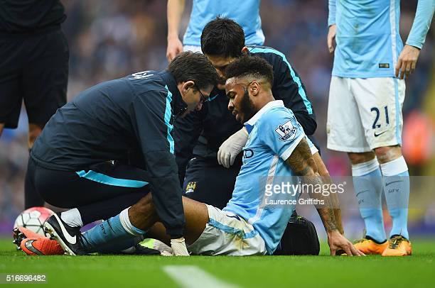 An injured Raheem Sterling of Manchester City is given treatment during the Barclays Premier League match between Manchester City and Manchester...