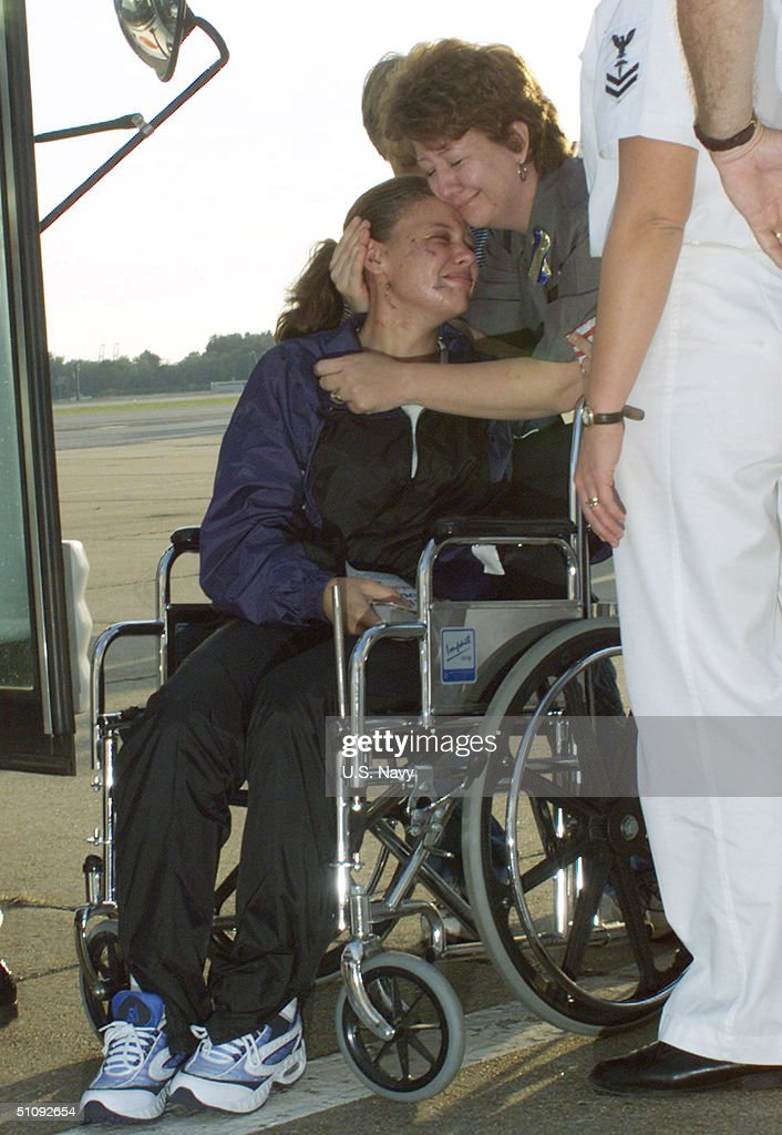 An Injured Sailor From The USS Cole (Ddg 67) Is Reunited With Her Mother October 15, 2000 At The Naval Air Station In Norfolk, Va. 33 Sailors Were Injured When A Suspected Terrorist Bomb Struck The U.S. Navy Destroyer USS Cole October 12. Six Remaining Injured Are Staying In Ramstein, Germany, Until Their Condition Becomes More Stable. (