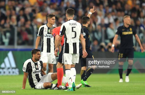 An injured Sami Khedira of Juventus looks dejected during the UEFA Champions League Semi Final second leg match between Juventus and AS Monaco at...