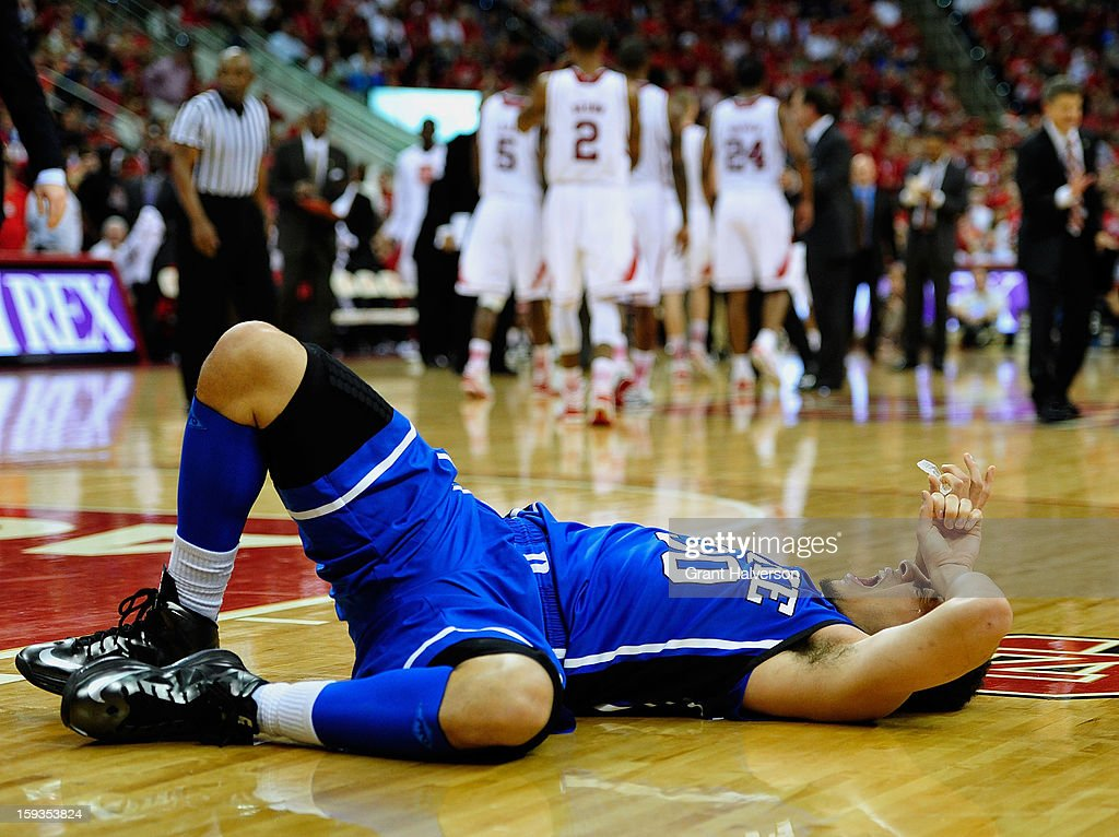 An injured Seth Curry #30 of the Duke Blue Devils lies on the floor during a loss to the North Carolina State Wolfpack during play at PNC Arena on January 12, 2013 in Raleigh, North Carolina. North Carolina State won 84-76.