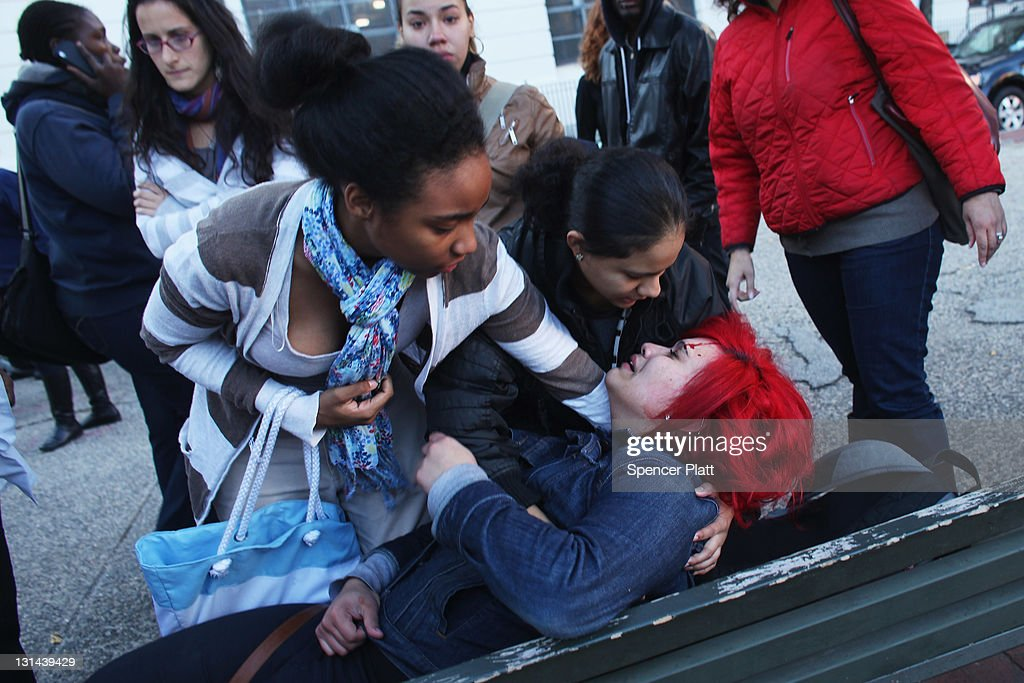 An injured student is aided by friends following a fight after school was let out on November 4, 2011 in lower Manhattan, New York City. Numerous students were detained by the police.