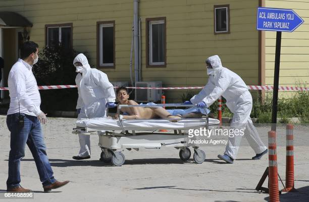 An injured Syrian boy is being brought to Reyhanli State Hospital in Hatay Turkey on April 4 2017 Assad regime's suspected chlorine gas attack took...