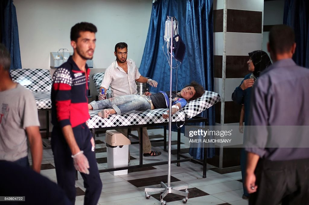 An injured Syrian boy receives treatment at a make-shift hospital following reported airstrikes in the rebel-held town of Outaya, east of the capital Damascus, on June 30, 2016. Five civilians including three children were killed by regime bombs that landed on eastern Ghouta, the Syrian Observatory for Human Rights reported. / AFP / AMER