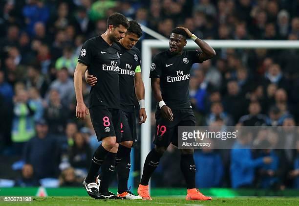 An injured Thiago Motta of Paris SaintGermain looks on alongside team mates Thiago Silva and Serge Aurier during the UEFA Champions League quarter...