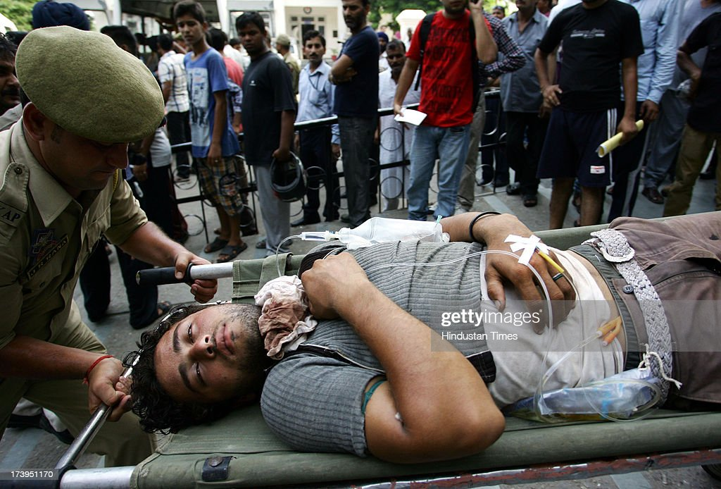 An injured victim of Ramban clash is shifted to Government Medical College Hospital on July 18, 2013 in Jammu, India. Four people were killed today when security personnel opened fire at a mob that had gathered at a BSF camp in Ramban district protesting against alleged manhandling of an Imam of the area by the force.