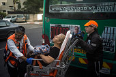 An injured woman is being transfered to a hospital after a Palestinian man attacked people in a bus on October 12 2015 in Jerusalem Israel Tensions...