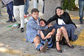 An injured woman is comforted following an explosion at the main train station in Turkey's capital Ankara on October 10 2015 At least 30 people were...