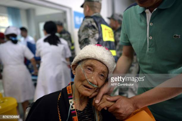 An injured woman is treated at Jiuzhaigou County Hospital two days after a 65magnitude earthquake hit southwest China's Sichuan province on August 10...