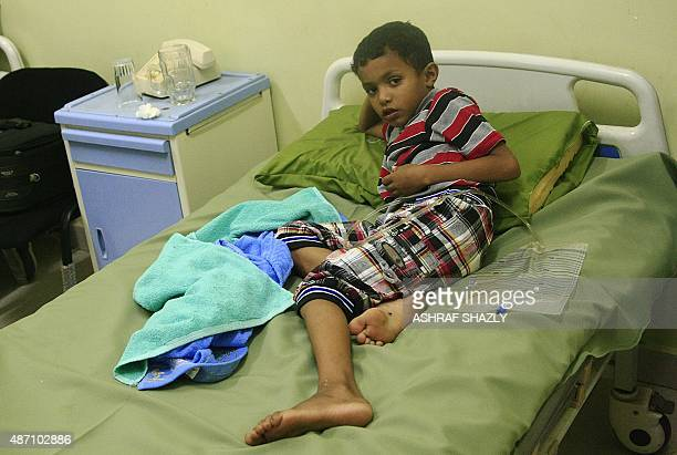 An injured Yemeni boy rests on a bed after receiving treatment at the Haj AlSafi hospital in the Sudanese capital Khartoum on September 9 2015 AFP...