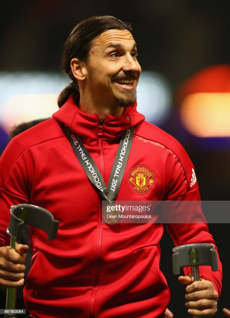 An injured Zlatan Ibrahimovic of Manchester United celebrates victory in the UEFA Europa League Final between Ajax and Manchester United at Friends Arena on May 24, 2017 in Stockholm, Sweden.