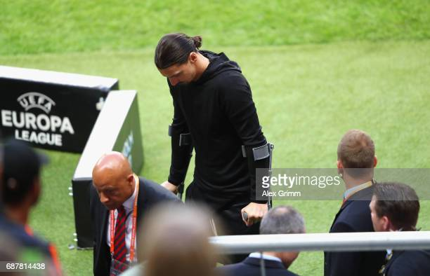 An injured Zlatan Ibrahimovic of Manchester United makes his way to the stands prior to the UEFA Europa League Final between Ajax and Manchester...