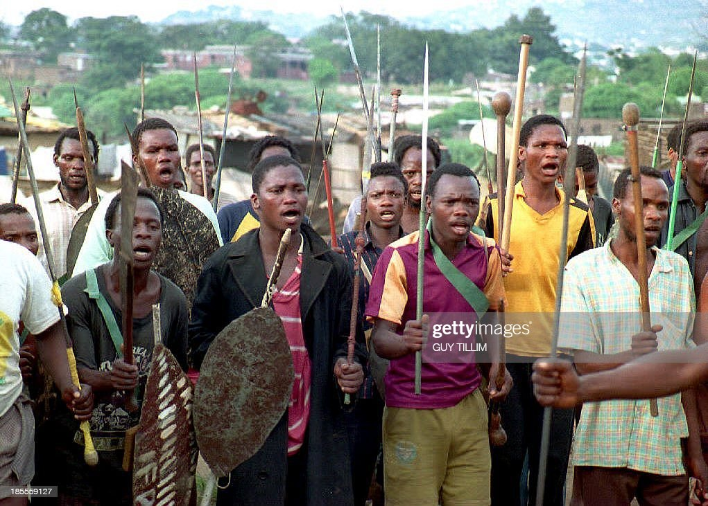 An Inkhata Impi parades in Bambhayi township in Durban 26 March 1994 as tensions increased with African National Congress supporters after clashes...