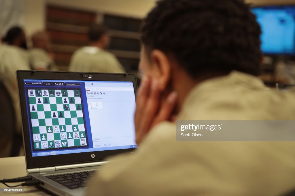 An inmate at the Cook County Jail compete in a chess tournament online with inmates from the Prison Complex of Viana in Espirito Santo state in Brazil on May 17, 2017 in Chicago, Illinois. Inmates from Cook County won the tournament 4.5-3.5. This is the third time the jail has organized an international chess competition for its inmates. The Cook County Jail, which houses more than 7,000 inmates, is the largest county jail in the country.