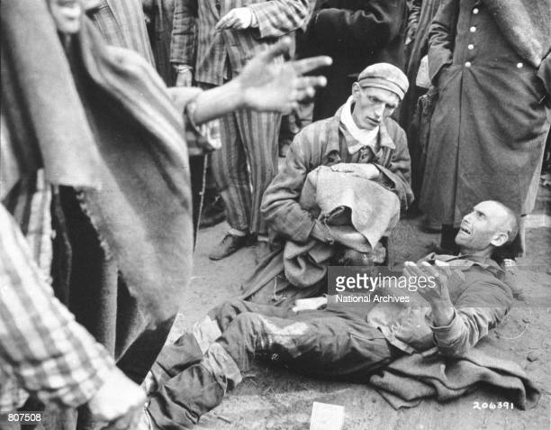 An inmate breaks out in tears as he finds out he is not leaving with the first group to the hospital May 4 1945 after the US liberation troops...