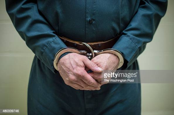 An inmate in handcuffs prepares to walk out for a parol board hearing at the New Hampshire State Prison for Men in Concord NH on Thursday July 02 2015