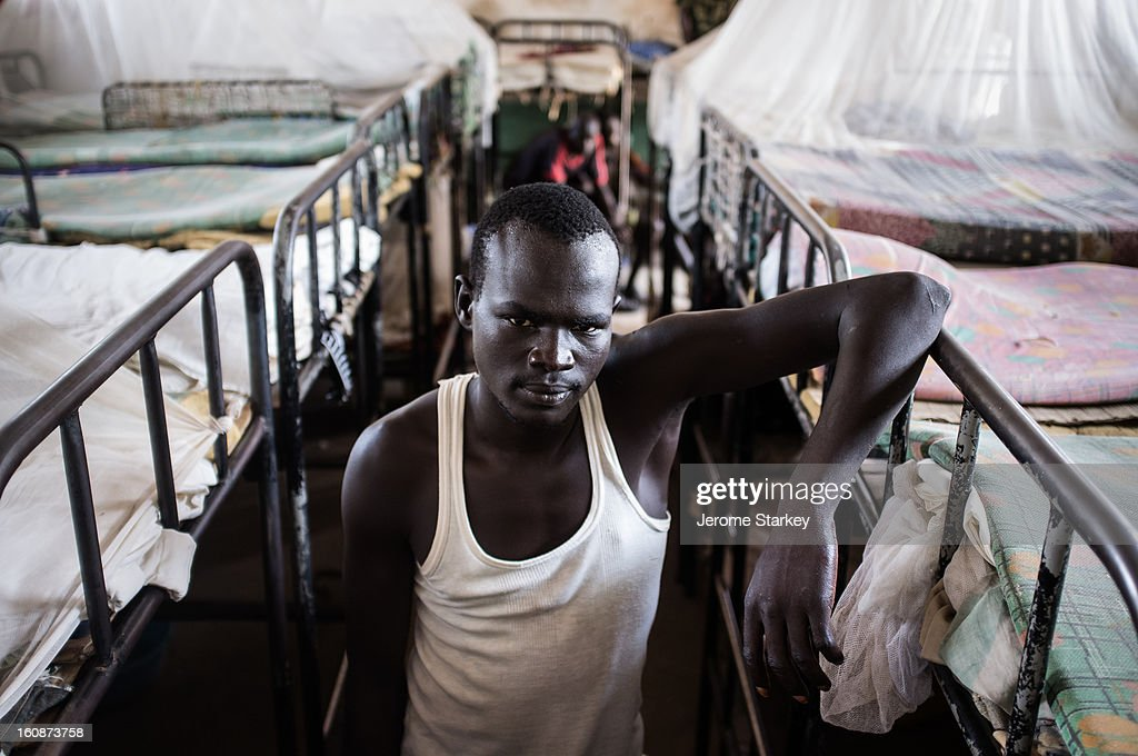 CONTENT] An inmate in Rumbek prison, in South Sudan, where around male prisoners live in four warehouse-like dormitories crammed with bunk beds, Oct 24, 2012. Few if any of the inmates said they had access to lawyers and around a third of the prisoners had spent months on remand awaiting trial, the guards said. South Sudan still executes prisoners convicted of murder, despite concerns about the lack of defence lawyers and a shortage of trained judges. Pairs of death row inmates are routinely shackled together, using leg-irons, to prevent them from escaping.