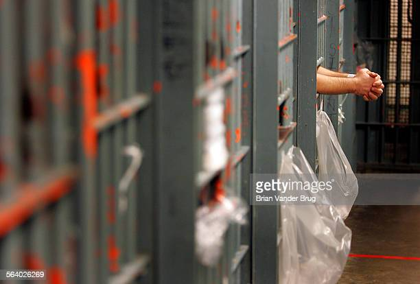 An inmate leans out the bars of his cell in a one–prisoner per cell block Crowded conditions at the Men's Central Jail in downtown Los Angeles...