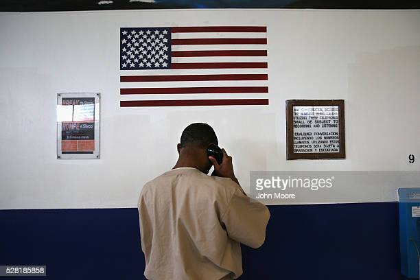 An inmate makes a call from the military Veterans Unit of the Cybulski Rehabilitation Center on May 3 2016 in Enfield Connecticut The Veterans Unit...