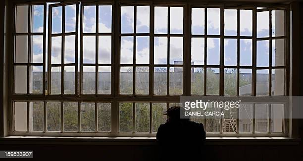 An inmate of the Borda neuropsychiatric hospital watches through a windows of the corridor that leads to the room where the sessions of tango therapy...