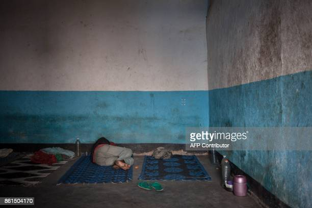 An inmate of the Bouar detention centre rests in a prison cell in Bouar western Central African Republic on October 13 2017 In the Central African...