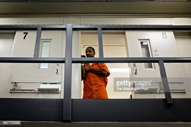 An inmate watches from his cell as DC Mayor Muriel Bowser tours DC Central Jail after announcing policy changes to support employment for inmates...