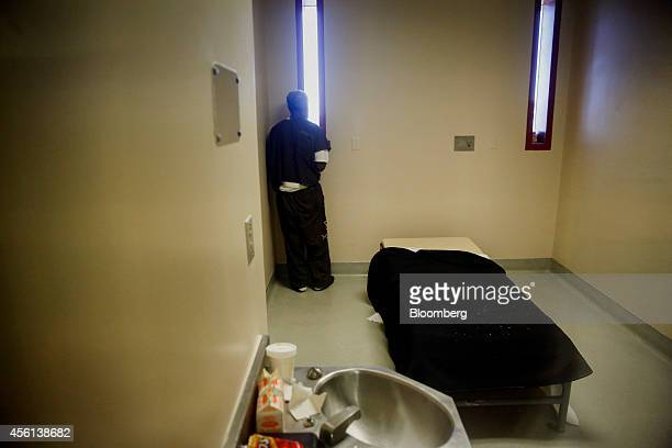 An inmate with mental health conditions looks out a window from the Forensic Inpatient Unit part of the Correctional Treatment Center Hospital at the...